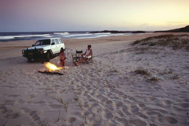 Four wheel drive on the beach, Australia