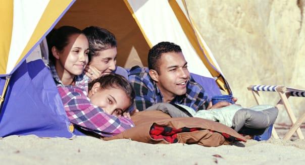 Family camping on sandy beach, California, USA