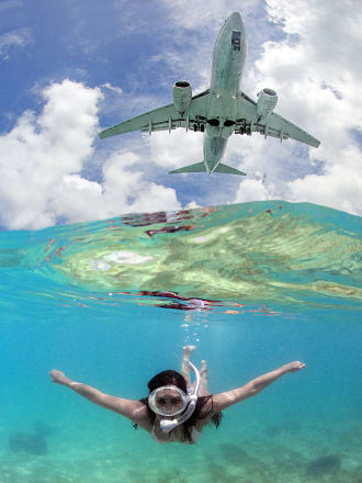 Amazing pics as jumbo jets photobomb tourists at tropical Caribbean resort