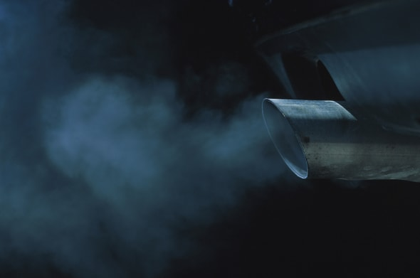 a exhaust pipe of a car emitting fumes