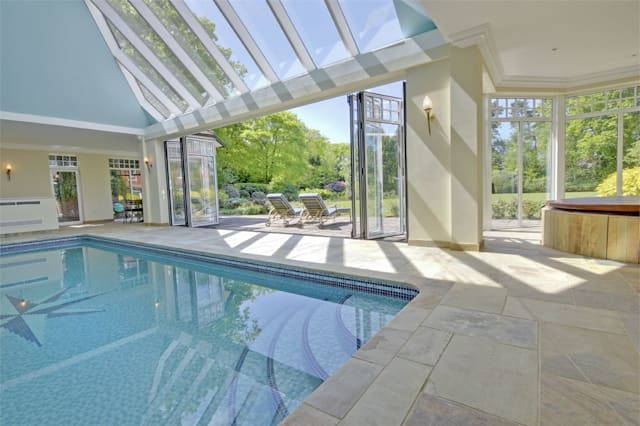 The swimming pool with glass roof