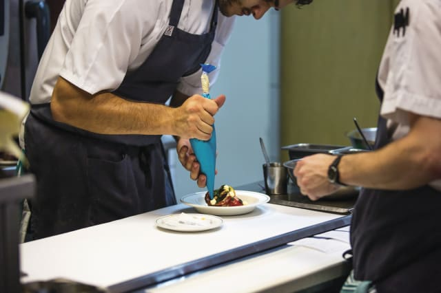 Chefs prepare food in the open kitchen of Cumulus Inc