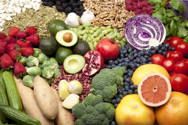 Large grouping of healthy superfoods, including strawberries, Brussels sprouts, chickpeas, blackberries, walnuts, blueberries, p