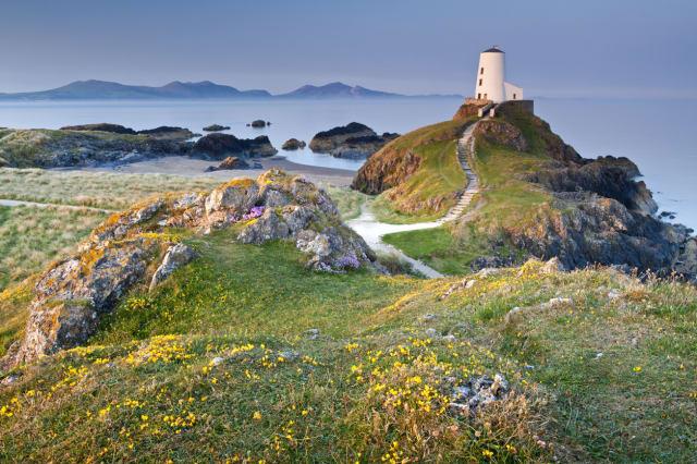 Llanddwyn Island  (Welsh: Ynys Llanddwyn)with the Mountains of The Lleyn Peninsula beyond, Isle of Anglesey, North Wales