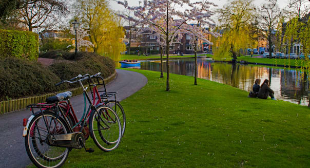 Cyclists relax at dutch canal