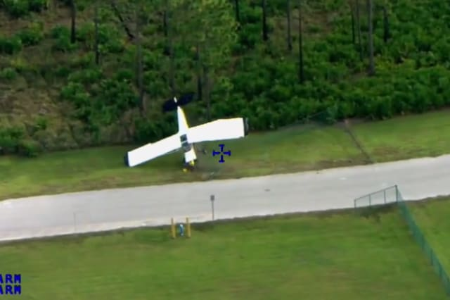 Plane crashes onto driving training course