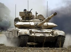 An Indian Army tank T-90 is seen during a military exercise in Jagraon, in the northern Indian state of Punjab, Friday, May 19, 2006. The Army is holding the Sanghe Shakti, one of its largest exercises, in Punjab to validate its new doctrine of a proactive strategy to overcome hostile forces. (AP Photo/Channi Anand)