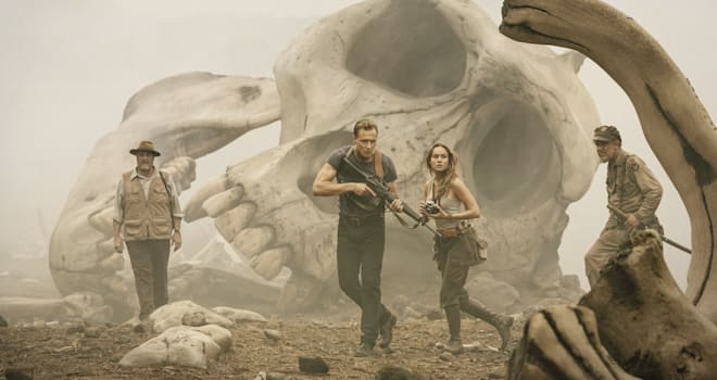 Bill Randa (John Goodman), Captain James Conrad (Tom Hiddleston), Weaver (Brie Larson), and Marlow (John C. Reilly) explore the boneyard in KONG: SKULL ISLAND
