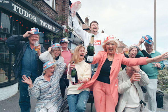 PICTURE - CONNORS, BRIGHTONLOTTE GUNDERSON, FIFTH FROM LEFT (WHITE JUMPER) CELEBRATING THE LOTTERY WIN WITH OTRHER REGULARS  OUTSIDE THE TUDOR TAVERN EAST PRESTON AND LENNY LOTTERY FROM THE SUN IN MAY 1997