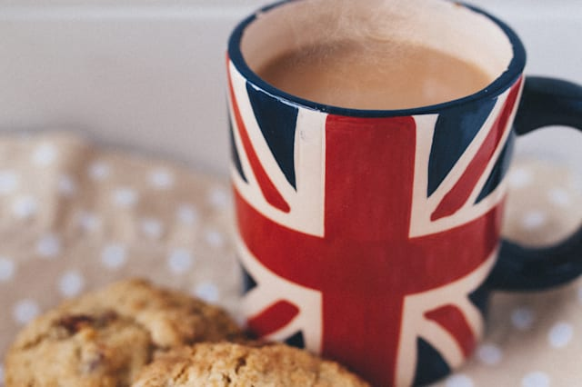 'Builder's tea' in a Union Jack flag mug with two homemade oat cookie biscuits