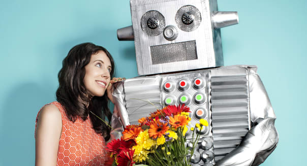 Robot Offering Young Woman Flower Bouquet