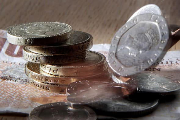 File photo dated 10/01/07 of money as the gap between the pay of top earners and the lowest-paid has