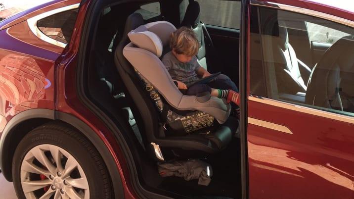 Kid in a Tesla Model X