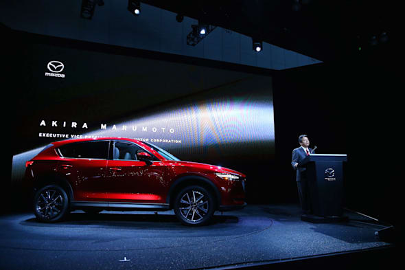 LOS ANGELES, CA - NOVEMBER 16:  Akira Marumoto, Executive Vice President of Mazda, speaks onstage at the Mazda press conference event at the L.A. Auto Show on November 16, 2016 in Los Angeles, California.  (Photo by Victor Decolongon/Getty Images for Mazda Motor Co.) *** Local Caption *** Akira Marumoto