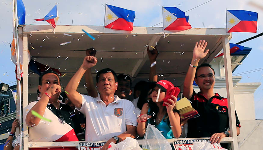 Rodrigo Duterte rides a motorcade through capital