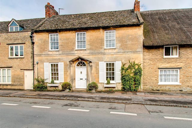 The double-fronted house in Bampton.