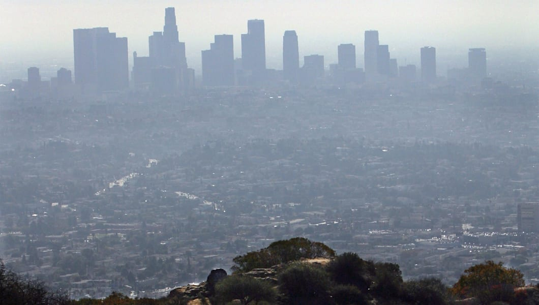 LOS ANGELES, CA. A family climbing the Mt. Hollywood Hiking Trail to overlook the downtown view of L