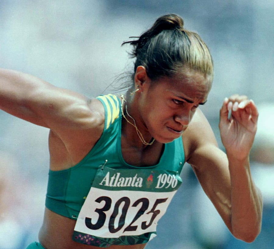 Cathy Freeman feels the burn in the Women's 400 metres qualifying round at the Atlanta