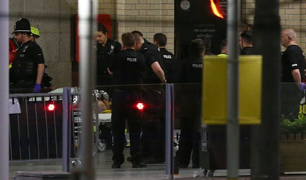 A person is wheeled away on a stretcher outside Victoria Station, close the Manchester Arena. A total...