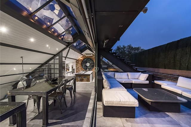 The dining area and terrace of the Shoreditch flat
