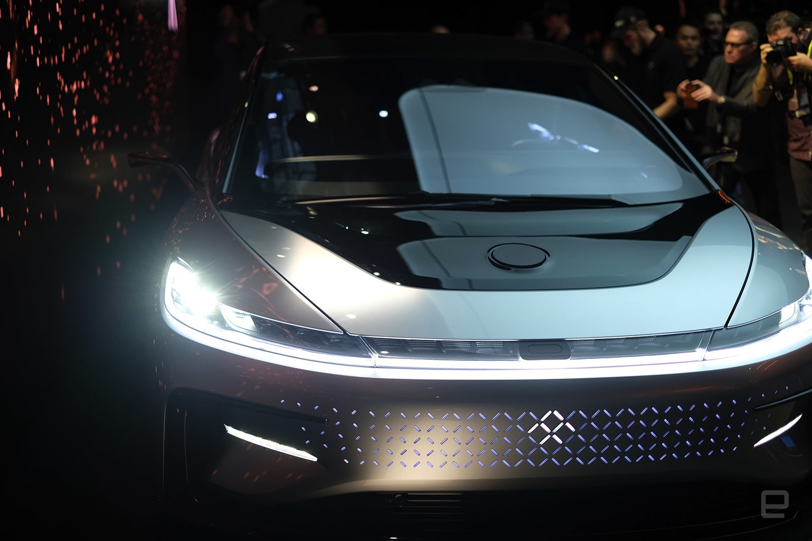 faraday future unveils an actual car the car has multiple modems for non stop broadband and two wifi hotspots with a person s personalized ffid the car will know exactly what you want to