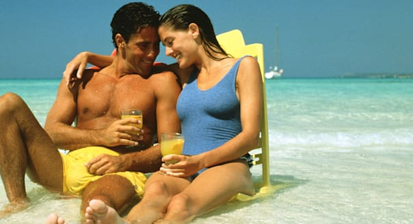 |adult|blue|caucasian|center|color|couple|day|drinking|exterior|green|honeymoon|horizontal|lifestyle|man|ocean|people|people and