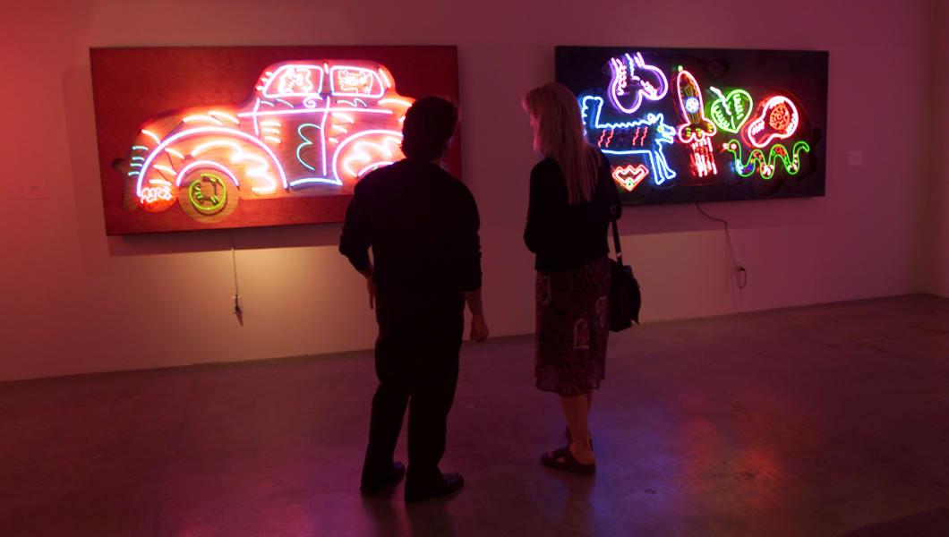 Sabatino Stefanile, left, and Victoria Priganano look at 'Aerosedan', left, and 'Rocket Car' at the