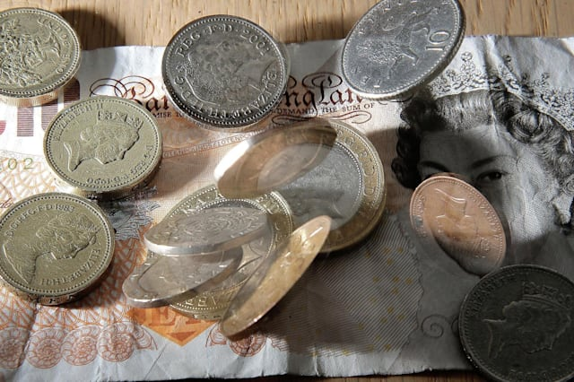 File photo dated 16/01/07 of money as it has been announced that the Living Wage is to increase by 20p to �7.85 an hour, boosting the pay of 35,000 workers. PRESS ASSOCIATION Photo. Issue date: Monday November 3, 2014. The new figure was revealed as a new study showed that 5.2 million people, or 22% of the workforce, are paid less than the Living Wage - an increase of 1% over the past year. The number of employers who have signed up to pay the Living Wage has more than doubled this year to over 1,000, including 18 in the FTSE 100, such as Standard Life and Canary Wharf Group. See PA story INDUSTRY Wage. Photo credit should read: Owen Humphreys/PA Wire