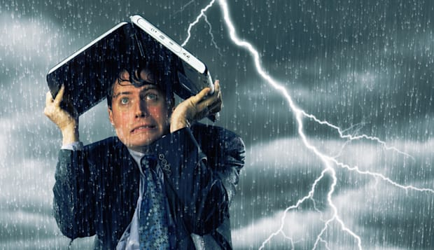 Businessman in lightning storm