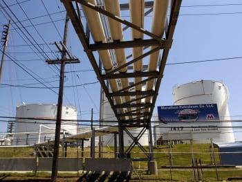 Pipes run toward storage tanks on the grounds of a Marathon