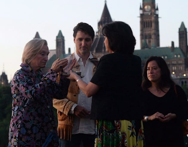 Prime Minister Justin Trudeau looks on as he is joined by Indigenous and Northern Affairs Minister Caroly...