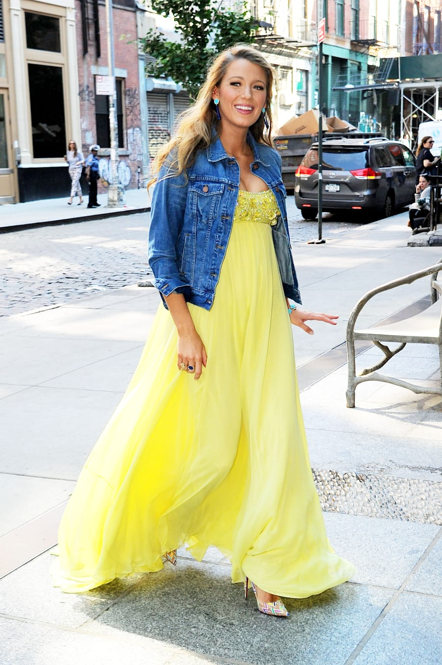 June 20 in Soho, Lively looks ethereal in a floaty yellow maxi paired with a denim jacket and Missoni