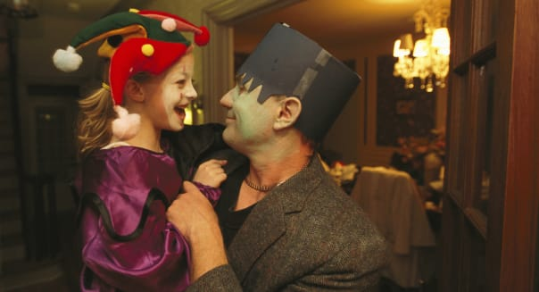 Lincoln, Nebraska. Wearing Halloween costumes, a father holds his daughter.