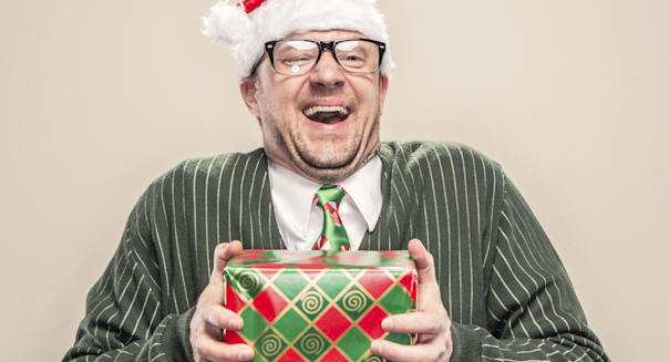 Nerdy Geek Christmas Man holding wrapped holiday gift