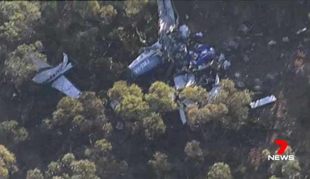 Footage taken from a Channel 7 helicopter shows the mangled wreck of the light plane which crashed with...