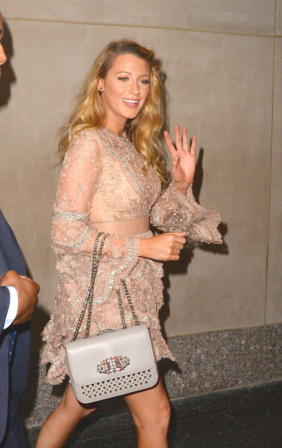 To top it off, that evening she opted for an embellished metallic mini dress and statement dove grey...