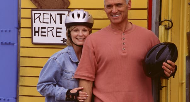 Couple standing in front of rental shop