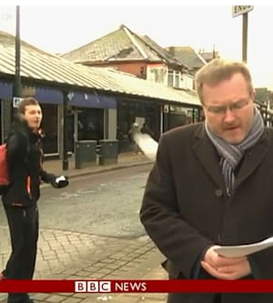 TV journalist pelted with snowball