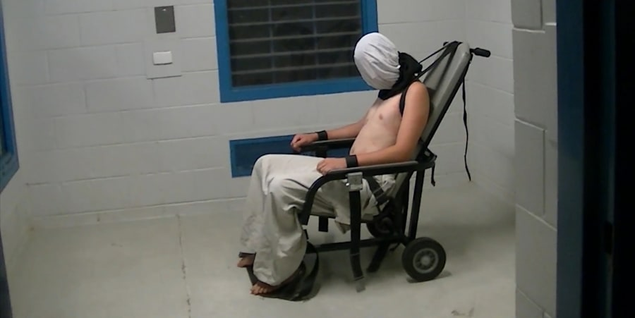 Dylan Voller is strapped to a restraint chair and a 'spit hood' placed on his face. on Monday he told...