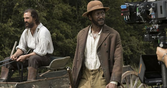While driving the horse wagon down a country road, Newt (Matthew McConaughey) tries to stop Moses (Mahershala Ali) in FREE STATE OF JONES