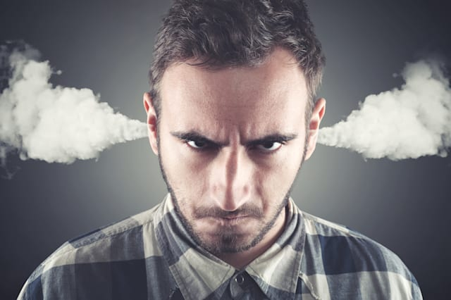 Angry young man, blowing steam coming out of ears, about to have nervous atomic breakdown. Negative human emotions, facial expre