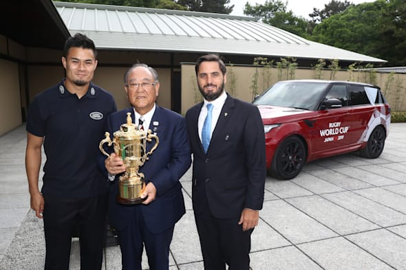 KYOTO, JAPAN - MAY 10:  (L-R) Yu Tamura of Japan, Fujio Mitarai, Chairman of the RWC 2019 Organising Committee and Agustin Pichot, Vice-Chairman of World Rugby pose with The William Webb Ellis Cup during the Rugby World Cup 2019 Pool Draw at the Kyoto State Guest House on May 10, 2017 in Kyoto, Japan.  (Photo by Dave Rogers - World Rugby/World Rugby via Getty Images)
