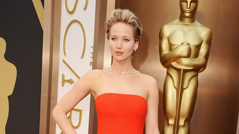 Jennifer Lawrence trips on the red carpet