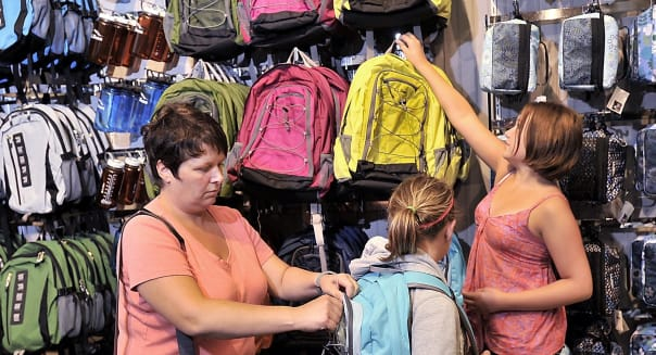 On Tuesday, August 13, 2013, surrounded by a wall of backpacks at L.L. Bean, Leanne MacKay helps her