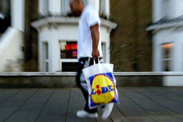 Generic, stock picture of a member of the public carrying a Lidl Supermarket shopping bag in London....