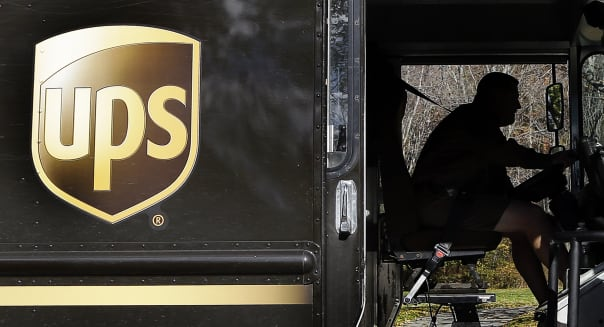 Earns UPS (In this Monday, Oct. 22, 2012, photo, a UPS driver drives after a delivery in North Andover, Mass. In this Monday, Oc