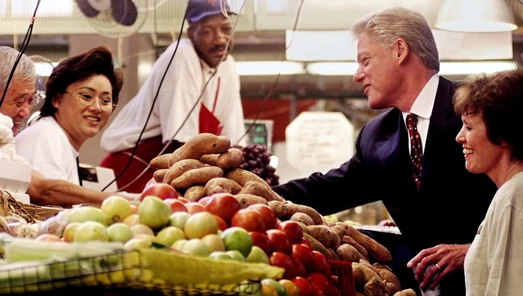 US President Bill Clinton talks with unidentified