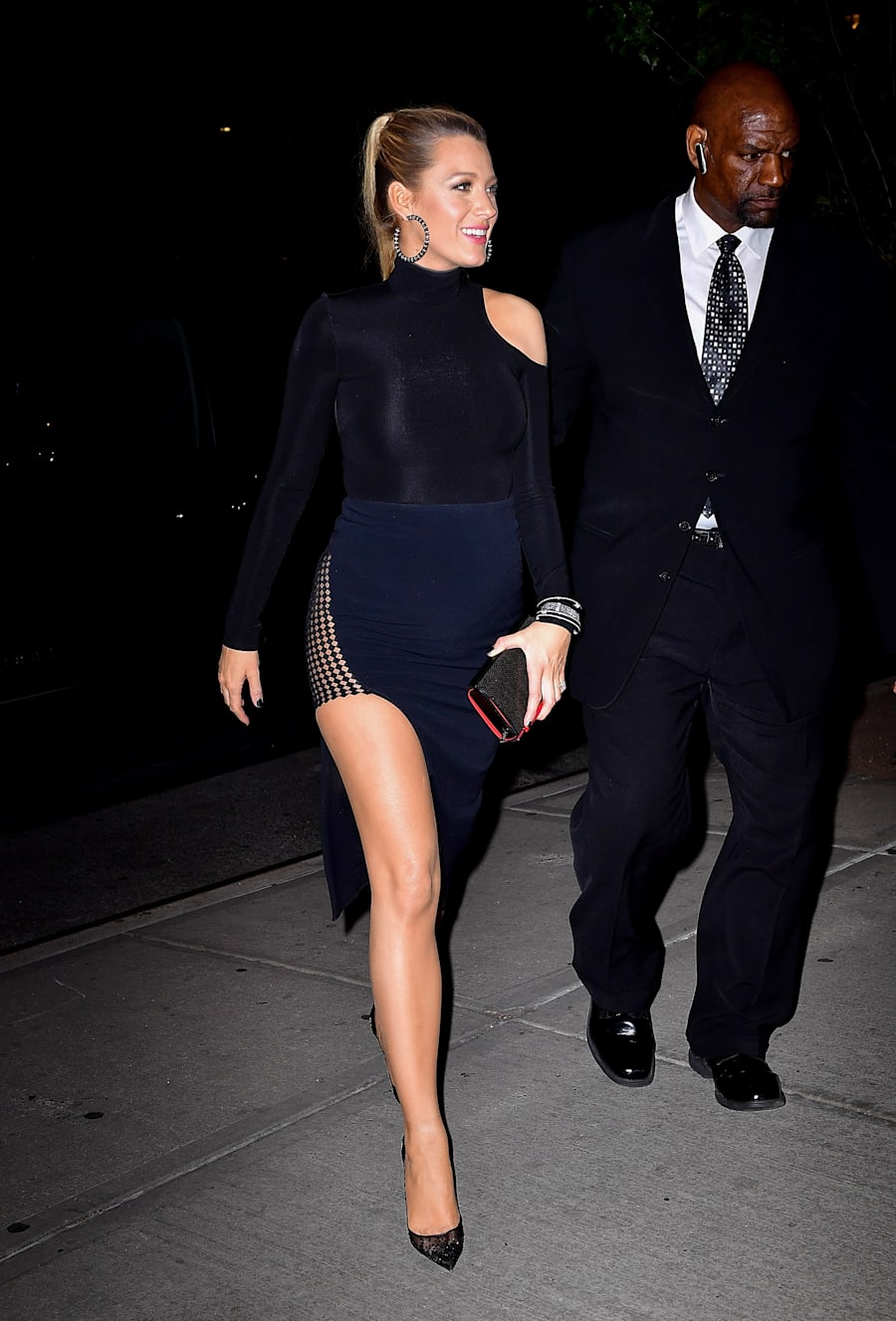 That same evening on the 21st Lively wore a black asymmetrical long sleeve bodysuit with a navy thigh...