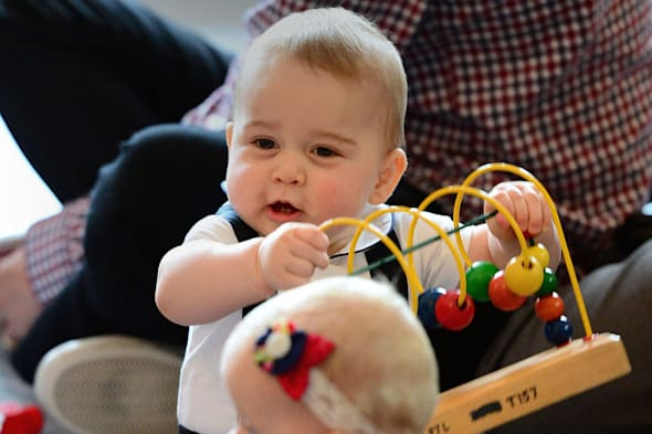 Prince George plays with toys as the Duke and Duchess of Cambridge and Prince George visit Plunket, a child welfare group at Government House, Wellington, during their official tour to New Zealand.   PRESS ASSOCIATION Photo. Picture date: Friday March 14, 2014. See PA story ROYAL Tour. Photo credit should read: Anthony Devlin/PA Wire