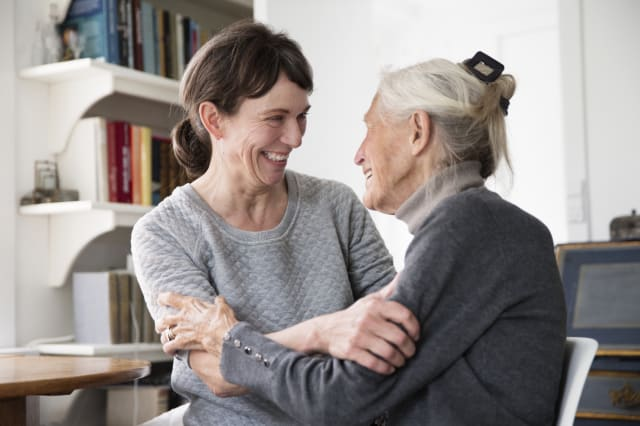 two generation women laughing together